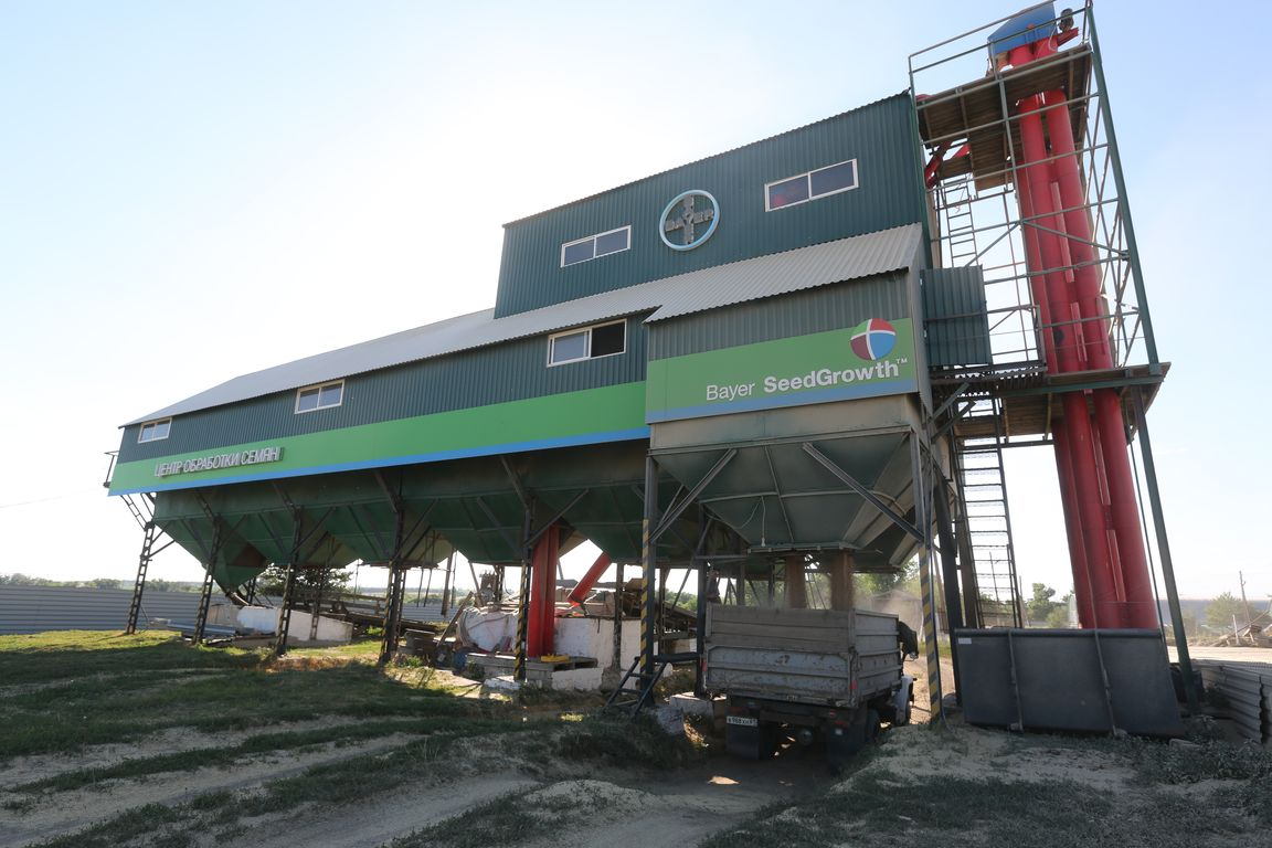 """A seeds treatment center. A wheat storage. Acros combine harvesters, manufactured by Rostselmash OJSC, during the summer wheat harvest on a farm operated by 'Svetlyi"""" Group of Companies, in Kamenka village, outside Rostov, Russia, July 5, 2019. http://gk-svetlyi.ru/"""